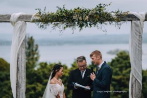 Wedding ceremony under rustic archway